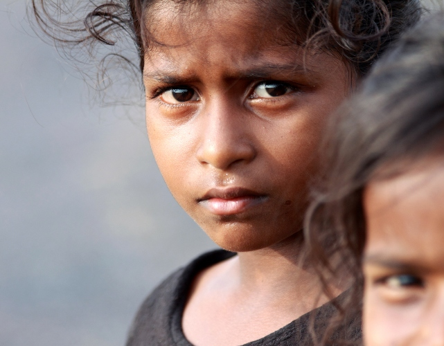Indian Rural Girl Looking at the camera with Grim Expression